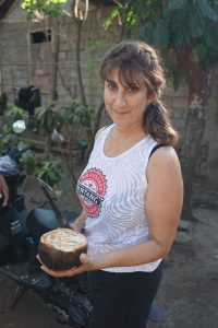 "Deena opens the ""coconut"" that is used for palm wine."